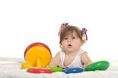 Baby girl playing with toys Stock Images
