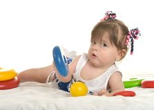 Baby girl playing with toys Royalty Free Stock Photos