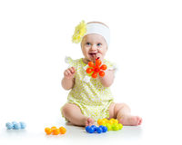 Baby girl playing with toys Stock Photo