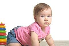 Baby girl playing Royalty Free Stock Image