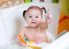 Baby playing and washing in bathroom Stock Photos