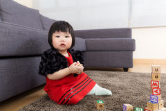 Baby girl playing wooden blocks Royalty Free Stock Images