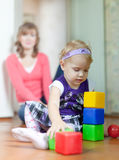 Baby girl plays with blocks Stock Photo
