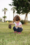 Baby Girl Plays On Grass Stock Image