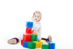 Baby girl plays with toy blocks Stock Image