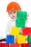 Baby girl plays with toy blocks Royalty Free Stock Photo