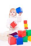 Baby girl plays with toy blocks Stock Photography
