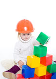 Baby girl plays with toy blocks Royalty Free Stock Photos