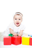 Baby girl plays with toy blocks Royalty Free Stock Images