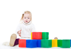Baby girl plays with toy blocks Royalty Free Stock Image