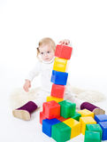 Baby girl plays with toy blocks Royalty Free Stock Photography