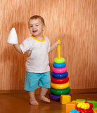 Baby girl plays with toys Stock Images