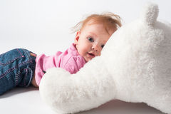 Baby girl plays with white bear toy Royalty Free Stock Image