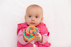 Baby girl portrait isolated. Baby girl portrait with lollipop, isolated Stock Images