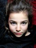 Beautiful girl. Portrait of little girl lying with black dress stock image