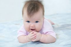 Baby girl portrait lying on bed Royalty Free Stock Photos
