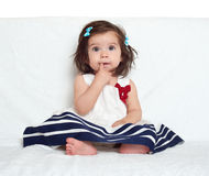 Baby girl portrait, sit on white towel Royalty Free Stock Images