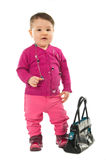 Baby girl posing with hand bag Stock Photo