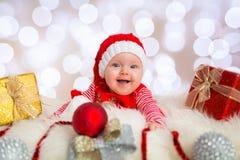 Baby girl posing in santa costume Stock Image