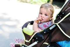 Baby girl in the pram Royalty Free Stock Image