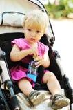 Baby girl in pram Stock Image