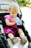 Baby girl in pram Stock Images