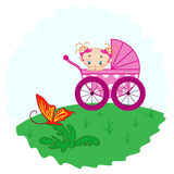 Baby girl from pram watching a butterfly Royalty Free Stock Image