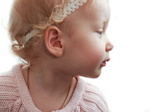 Baby girl in profile. On a white background. portrait Stock Images