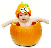 Baby girl in pumpkin Stock Photos