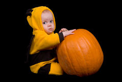 Baby Girl with a pumpkin Stock Image