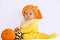 Baby girl with pumpkin Royalty Free Stock Photos
