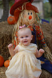 Baby girl in Pumpkin Patch Royalty Free Stock Images