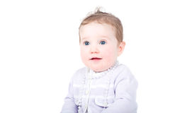 Baby girl in purple cardigan with pearl necklace Royalty Free Stock Images
