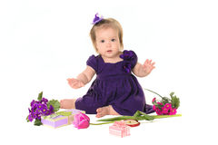 Baby girl purple dress with flowers Royalty Free Stock Photography