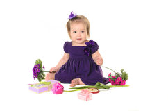 Baby girl purple dress with flowers Royalty Free Stock Images
