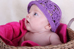 Baby girl with purple hat Royalty Free Stock Photos