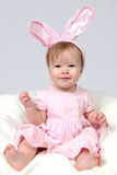 Baby Girl With Rabbit Ears Stock Photo