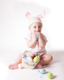Baby girl in a rabbit hat Stock Image