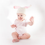 Baby girl in a rabbit hat Stock Photography