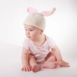 Baby girl in a rabbit hat Stock Images