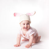 Baby girl in a rabbit hat Royalty Free Stock Photography