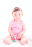 Baby girl with rattle teether toy. Beautiful baby girl with rattle teether toy stock photography