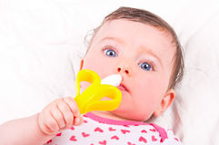 Baby girl with rattle teether toy. Image of baby girl with rattle teether toy stock photography