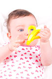 Baby girl with rattle teether toy. Image of baby girl with rattle teether toy stock images