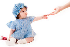 Baby girl reaches out Stock Photo