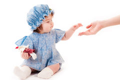 Baby girl reaches out. concept of help Stock Photography