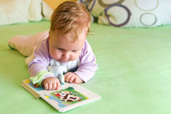 Baby girl reading royalty free stock image