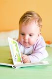 Baby girl reading stock photos