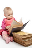 Baby girl reading book Stock Photo