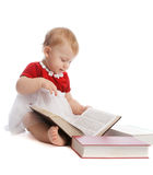 Baby girl reading a book Royalty Free Stock Image